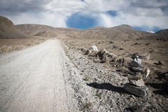 Tajikistan. Pamir highway. Road to the clouds. Toned.  Royalty Free Stock Photos