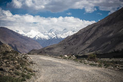 Tajikistan. Pamir highway. Road to the clouds. Toned.  Royalty Free Stock Images