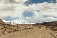 Tajikistan. Pamir highway. Road to the clouds. Toned Stock Photo