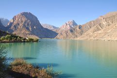 Tajikistan Pamir travels. On the shores of Iskander Kul lake in Tajikistan - in the footsteps of Alexander the Great in Central Asia Stock Images