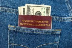 Tajikistan passport and dollar bills Stock Photos