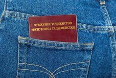 Tajikistan passport in the jeans pocket Stock Photo