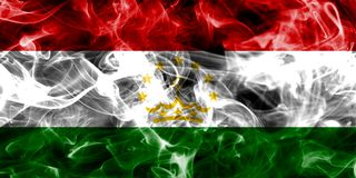 Tajikistan smoke flag isolated on a black background.  Royalty Free Stock Images
