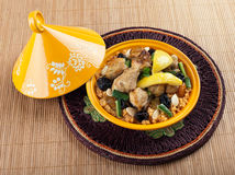 Tajine, moroccan chicken with lemon confit. And cous cous Royalty Free Stock Image
