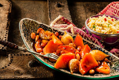 Tajine Vegetable Dish and Couscous on Wood Table Stock Photos