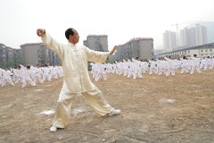 Tajiquan performance. Many taijiquan practicers are performancing in opening ceremony of lianyungang city Games Scene is very spectacular royalty free stock photo