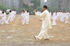 Tajiquan performance. Many taijiquan practicers are performancing in opening ceremony of lianyungang city Games Scene is very spectacular royalty free stock photography