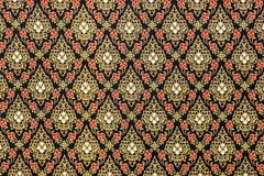 Tajlandzcy wzory w Czarnym i Złocistym na Jedwabniczej tkaninie Zdjęcie Royalty Free