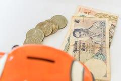 Tajlandzka waluta oba monety i banknoty fotografia stock