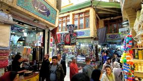 Tajrish Bazaar, Tehran, Iran. TEHRAN, IRAN - OCTOBER 25, 2017: Curved alleyway of Tajrish Bazaar with different stalls, carpet shops, the coffee house, offering stock footage