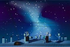 Tak av hus med lampglas under natthimlen med det mjölkaktigt Arkivbild