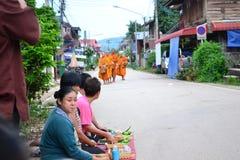 Tak bat kaonew at Chiangkhan royalty free stock photo