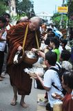 Tak Bat Khao Niaw: Giving sticky rice and food to the monks Stock Image