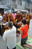 Tak Bat Khao Niaw: Giving sticky rice and food to the monks Royalty Free Stock Photography