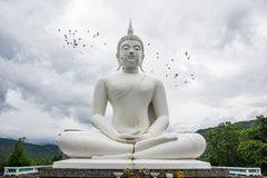 Outdoor large white Buddha Image Buddhist temple Royalty Free Stock Photography
