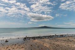 Takapuna beach with Rangitoto Island Stock Images