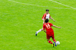 Takashi Usami from Bayern Munich. On the field kicking the ball in a friendly match Royalty Free Stock Photography