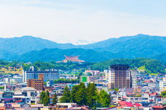 Takayama City Landscape Snow-Capped Mountain H. Telephoto landscape of Takayama city, Sukyo Mahikari World Headquarters and snow-capped mountain range in layers Stock Photo