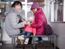 Takayama, Japan - April 16, 2018 : Single mom family in shinhotaka ropeway. Single mom family in shinhotaka ropeway royalty free stock image