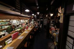 A pack of tourists dinning asian traditional vegetarian cuisine in Heianraku restaurant in Takayama city. royalty free stock photography