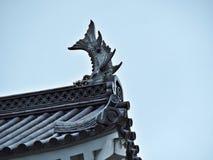 Takdetaljer av den Aizuwakamatsu slotten i Japan royaltyfri bild