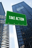 Take action against low angle view of skyscrapers Royalty Free Stock Photography