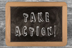 Take Action!. Chalkboard with 3D outlined text - on wood Stock Images