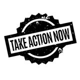 Take Action Now rubber stamp Stock Photo