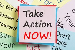 Take Action Now written on note. Business Concept. Top view Royalty Free Stock Image