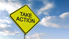 Take action sign against blue sky