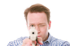 Take aim. Headshot of a casual handsome young man pointing his gun at you  -  on white Stock Images