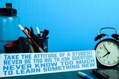 Take the attitude of a student. Never be too big to ask question. never know too much to learn something new P. Lanning on Background of Working Table with royalty free stock photography