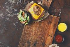 Take away burger menu on wooden tray copy space Royalty Free Stock Photo