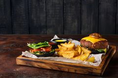 Take away burger menu on wooden tray Royalty Free Stock Photography