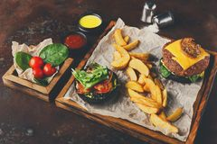 Take away burger menu on wooden tray top view Royalty Free Stock Photos
