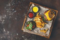 Take away burger menu on wooden tray top view Stock Photography
