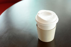 Take away coffee cup on the table Royalty Free Stock Images