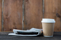 Take away coffee and newspaper Royalty Free Stock Photos