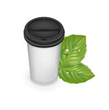 Take away cup of fresh coffee with leaves Stock Image
