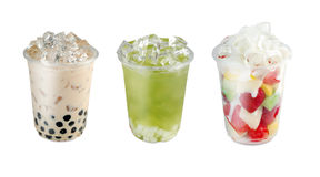 Take away drinks. Take away green tea with ice and plastic cup of green tea (matcha) with jelly and tapioca bubble milk tea Stock Images