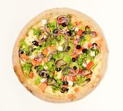 Take away food with crunchy edges. Greek pizza. With black olives. Italian cuisine and food delivery concept. Pizza with tomatoes, feta cheese, salad and red royalty free stock images