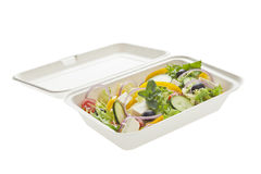 Take away greek salad. Take out greek salad in biodegradable paper container. Clipping Path Stock Photos
