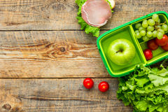 Take away with lunchbox and fresh food on wooden background top view space for text Royalty Free Stock Photo