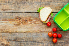 Take away with lunchbox and fresh food on wooden background top view space for text Royalty Free Stock Images
