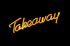 Take away neon sign. Illuminated neon sign advertising take away or carry out Stock Photography