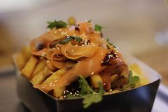 A takeaway plate with potato chips and Korean carrot and seeds royalty free stock images