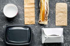 Take away with sandwich and paper bags on table background top view Stock Photo