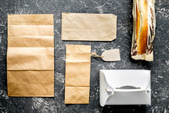 Take away with sandwich and paper bags on table background top view Royalty Free Stock Photos