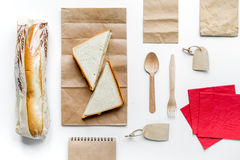 Take away with sandwich and paper bags on table background top view Royalty Free Stock Photo