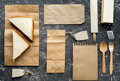 Take away with sandwich and paper bags on table background top view mock up Royalty Free Stock Photos